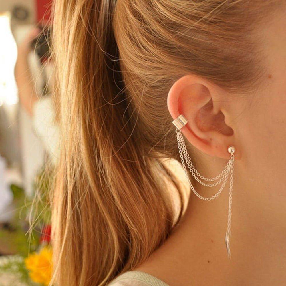 Srebrne i złote kolczyk nausznica łańcuszki z listkiem i klipsem zakładanym na ucho.